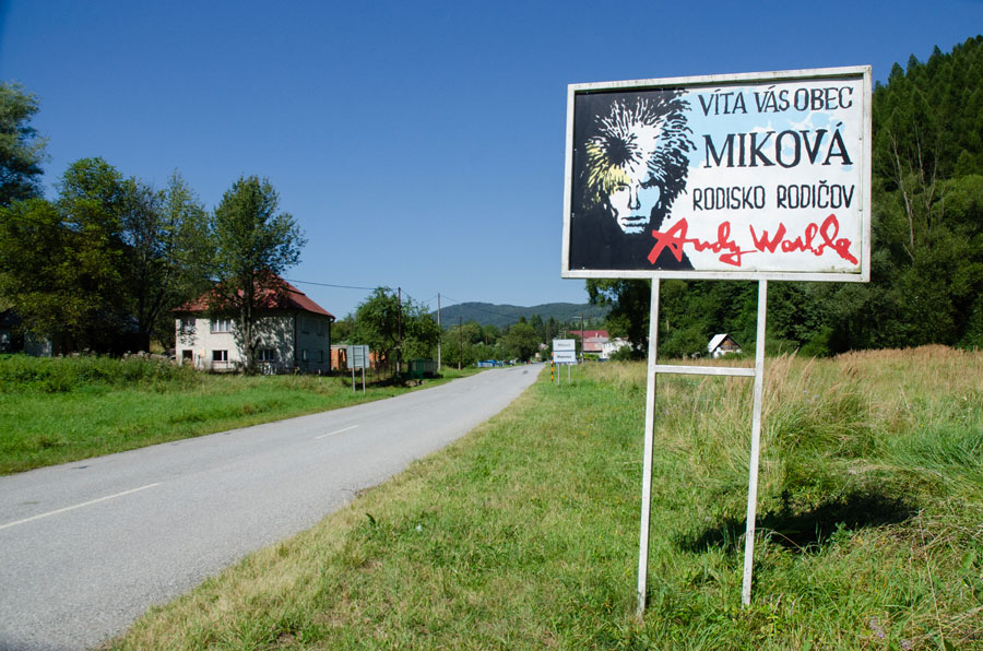 Welcome sign in Mikova with image of Andy Warhol